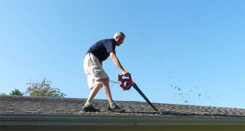 cleaning gutters with leaf blower